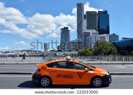 BRISBANE, AUS - SEP 25 2014:Taxicab and pedestrian pass on Victoria bridge in Brisbane, Australia.The Victoria Bridge is a vehicular and pedestrian bridge over the Brisbane River. - stock photo