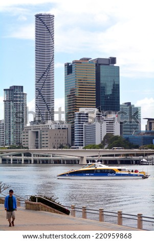 BRISBANE, AUS - SEP 25 2014: Visitor at the South Bank of Brisbane under the skyline of infinity Tower. Its a 249-metre (817 ft) skyscraper. Infinity Tower is the tallest building in Brisbane today. - stock photo