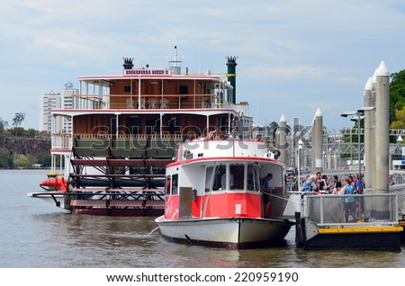 BRISBANE, AUS - SEP 25 2014:Visitors getting off CityFerry at Eagle Street Pier ferry wharf in Brisbane, Australia.In January 2011 it sustained damage during the devastating floods. - stock photo