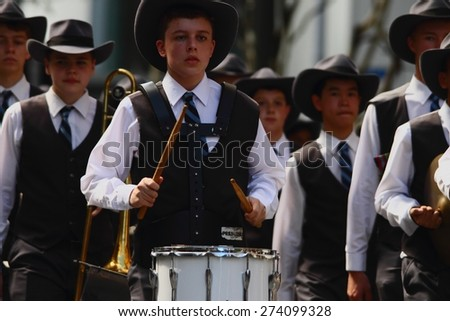 BRISBANE, AUSTRALIA - APRIL 25 : Drummer boy playing march tune during Anzac day centenary commemorations April 25, 2015 in Brisbane, Australia - stock photo