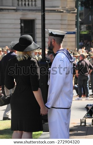BRISBANE, AUSTRALIA - APRIL 25 : Sailor and partner spectating during Anzac day centenary commemorations April 25, 2015 in Brisbane, Australia - stock photo