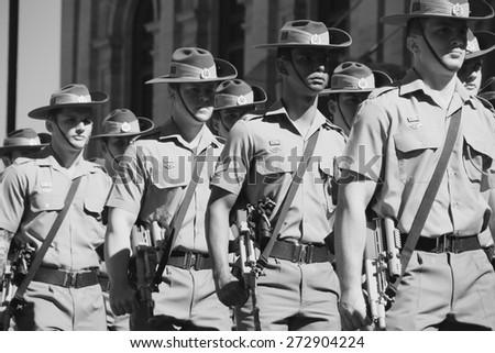 BRISBANE, AUSTRALIA - APRIL 25 : 1st Battalion march  along the route during Anzac day centenary commemorations April 25, 2015 in Brisbane, Australia - stock photo