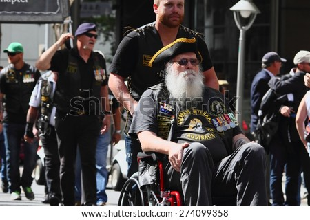 BRISBANE, AUSTRALIA - APRIL 25 : Veitnam veterans march along the route during Anzac day centenary commemorations April 25, 2015 in Brisbane, Australia - stock photo