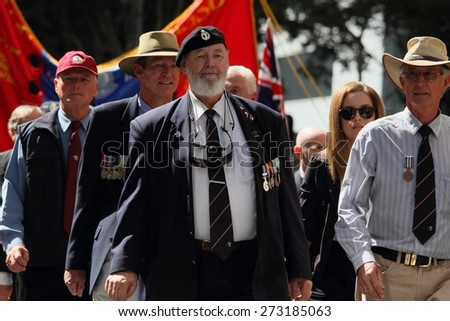 BRISBANE, AUSTRALIA - APRIL 25 : Veterans march along the route during Anzac day centenary commemorations April 25, 2015 in Brisbane, Australia