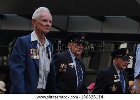 BRISBANE, AUSTRALIA - APRIL 25 : Veterans march along the route during Anzac day commemorations  April 25, 2013 in Brisbane, Australia - stock photo