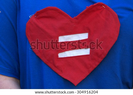 BRISBANE, AUSTRALIA - AUGUST 8 2015:Equal love heart shirt at Marriage Equality Rally August 8, 2015 in Brisbane, Australia - stock photo