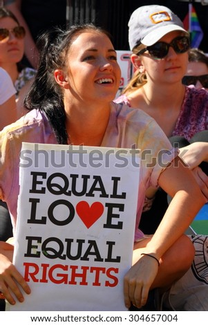 BRISBANE, AUSTRALIA - AUGUST 8 2015: Unidentified rally goers with equal love pro-gay marriage sign at Marriage Equality Rally August 8, 2015 in Brisbane, Australia - stock photo