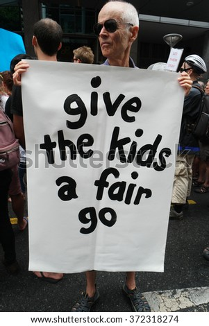 BRISBANE, AUSTRALIA - FEBRUARY 05 :Anti children in detention sign at protest in support of churches offering sanctuary to refugees February 05, 2016 in Brisbane, Australia - stock photo