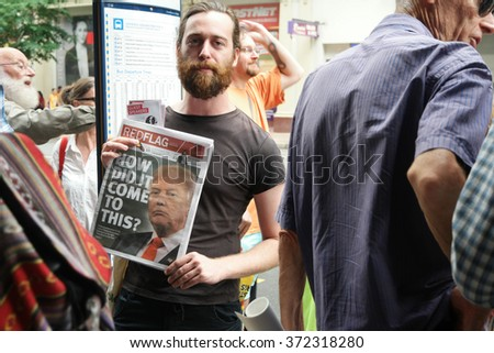 BRISBANE, AUSTRALIA - FEBRUARY 05 : Anti right wing newspaper at protest in support of churches offering sanctuary to refugees February 05, 2016 in Brisbane, Australia - stock photo
