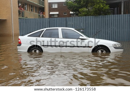BRISBANE, AUSTRALIA - JANUARY 28 : Car submerged from ex tropical cyclone Oswald on January 28, 2013 in Brisbane, Australia - stock photo