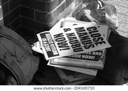 BRISBANE, AUSTRALIA - JULY 12 : Anti government refugee policy flyers outside Liberal National Party national conference July 12, 2014 in Brisbane, Australia - stock photo