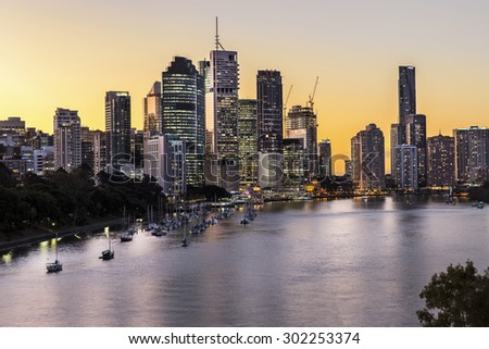 BRISBANE, AUSTRALIA - JULY 30 2015: Brisbane City sunset riverside and harbour, from Kangaroo Point Cliffs