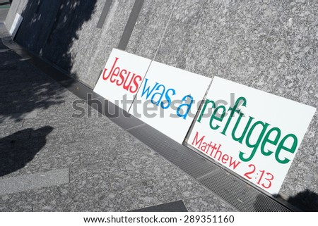 BRISBANE, AUSTRALIA - JUNE 20: Anti- immigration policy signs at World Refugee Day Rally