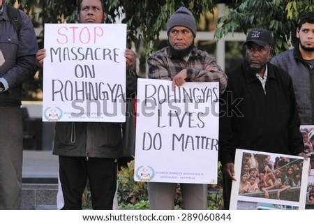 BRISBANE, AUSTRALIA - JUNE 20 : Burmese Rohingya Association members protesting as part of World Refugee Rally June 20, 2015 in Brisbane, Australia - stock photo