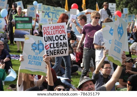 BRISBANE, AUSTRALIA - JUNE 6 : crowds with say Yes to cutting carbon pollution and clean energy signs at rally during World Environment Day say yes protest 6, 2011 in Brisbane, Australia - stock photo