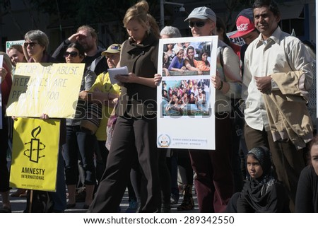 BRISBANE, AUSTRALIA - JUNE 20 :Greens Senator Larissa Waters and others listening to speeches at the World Refugee Rally June 20, 2015 in Brisbane, Australia - stock photo