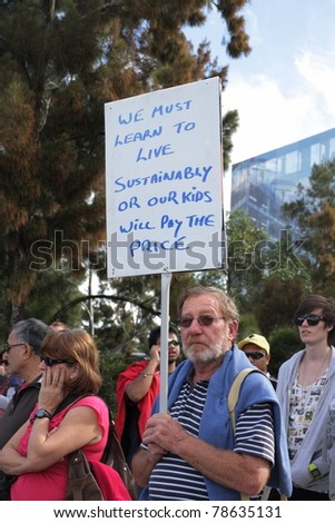 BRISBANE, AUSTRALIA - JUNE 6 : man with sustainability sign during World Environment Day say yes protest 6, 2011 in Brisbane, Australia - stock photo