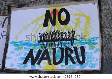 BRISBANE, AUSTRALIA - JUNE 20 : Sign calling for closure of the Naura Island detention center at World Refugee Day