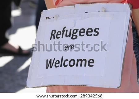 BRISBANE, AUSTRALIA - JUNE 20 : Sign suggesting ordinary Australians welcome refugess at World Refugee Day Rally June 20, 2015 in Brisbane, Australia - stock photo