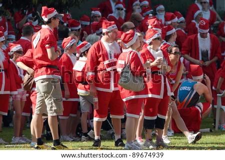 BRISBANE, AUSTRALIA  NOV 27 :Group of unidentified santas gather for warm up pre Variety Santa Fun Run November 27, 2011 in Brisbane, Australia - stock photo