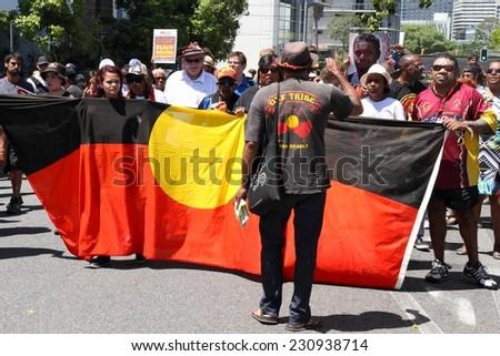 BRISBANE, AUSTRALIA - NOVEMBER 14: Aboriginals street marching protesting deaths in custody at g20 on November 14, 2014 in Brisbane, Australia - stock photo