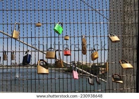 BRISBANE, AUSTRALIA - NOVEMBER 14: Love locks on kurilpa bridge during g20 city security lock down on November 14, 2014 in Brisbane, Australia - stock photo