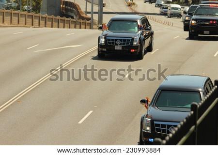 BRISBANE, AUSTRALIA - NOVEMBER 15: President Obama motorcade from UQ visit g20 sumimit 15, 2014 in Brisbane, Australia - stock photo
