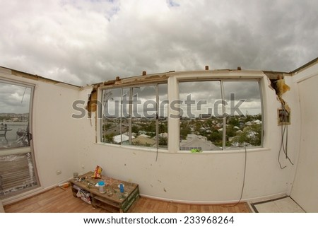 BRISBANE, AUSTRALIA - NOVEMBER 28 : Roof blown off unit from super cell hail storm area declared disaster on November 28, 2014 in Brisbane, Australia - stock photo
