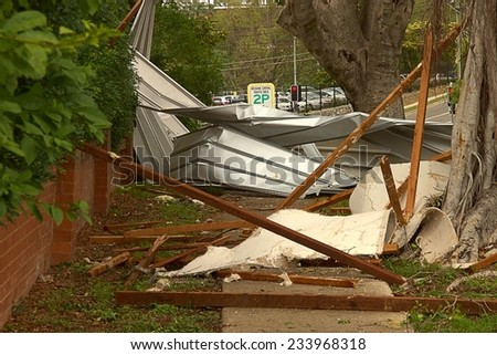 BRISBANE, AUSTRALIA - NOVEMBER 28 : Roof on footpath from super cell hail storm area declared disaster on November 28, 2014 in Brisbane, Australia - stock photo