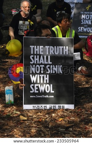 BRISBANE, AUSTRALIA - NOVEMBER 15: Undentified people protesting Sewol ferry disaster at g20 protest on November 15, 2014 in Brisbane, Australia