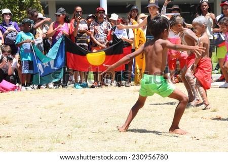 BRISBANE, AUSTRALIA - NOVEMBER 14: Unidentified Aboriginal dancers at deaths in custody g20 protest on November 14, 2014 in Brisbane, Australia - stock photo