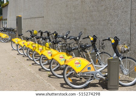 Brisbane, Australia - September 25, 2016: Bikes from the CityCycle programme, to encourage cycling, lining up in one of the stations in Brisbane.