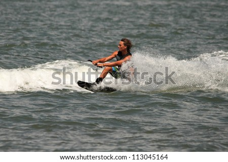 BRISBANE, AUSTRALIA - SEPTEMBER 15 :  World champion Cory Teunissen giving wakeboarding demonstration as part of Australian Water Ski Racing Championship on September 15, 2012 in Brisbane, Australia