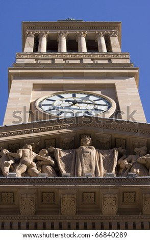 Brisbane City Hall Clock Tower Against A Blue Sky - stock photo