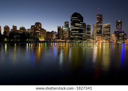 brisbane city skyline at dusk by river