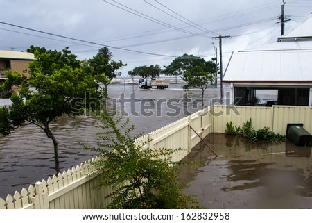 BRISBANE, QLD, AUSTRALIA - January 27: A Brisbane City Council truck drives through the flooded streets of Sandgate on 27 January 2013 - stock photo
