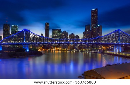 BRISBANE,QLD/AUSTRALIA - JANUARY 10, 2016: Brisbane skyline and blue illuminated Story bridge at night