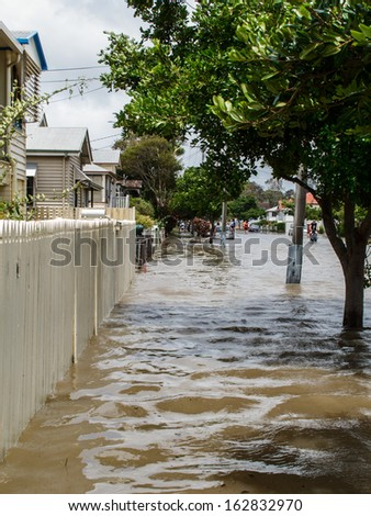 BRISBANE, QLD, AUSTRALIA - January 27: Flood in Sandgate in Brisbane, with flood waters covering all the road and pavement on 27 January 2013 - stock photo