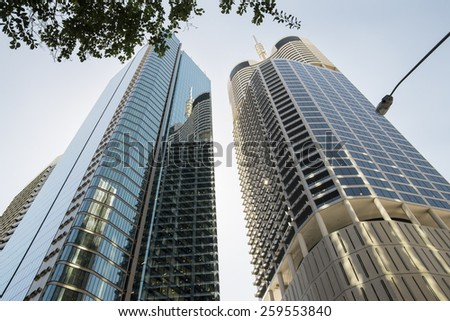 BRISBANE, QLD, AUSTRALIA - MARCH 17, 2014: perspective view to steel and glass high rise building skyscraper commercial modern city on riverside in Brisbane, QLD, Australia on March 17, 2014 - stock photo