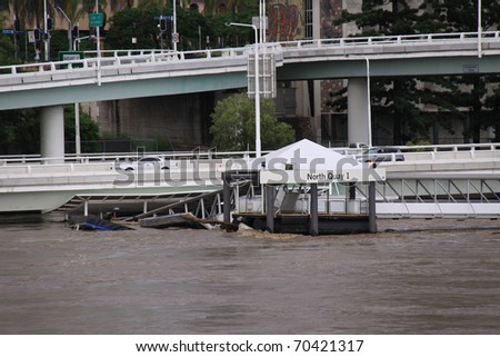 "BRISBANE, QUEENSLAND/AUSTRALIA - JANUARY 13: Destroyed City Cat ""North Quay"" on January 13, 2011 in CBD, Brisbane, Queensland, Australia. - stock photo"