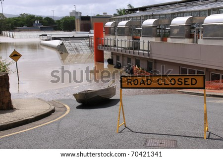BRISBANE, QUEENSLAND/AUSTRALIA - JANUARY 13: Flooded Queensland University section on January 13, 2011 in St Lucia, Brisbane, Queensland, Australia. - stock photo