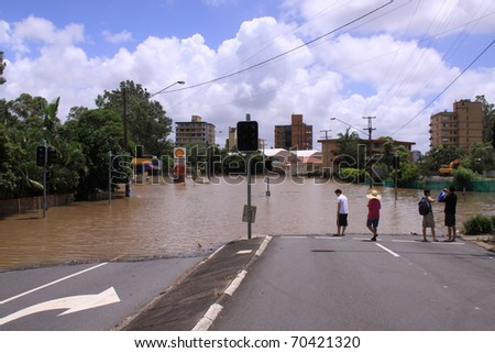 BRISBANE, QUEENSLAND/AUSTRALIA - JANUARY 13: Flooded street on January 13, 2011 in Toowong, Brisbane, Queensland, Australia. - stock photo