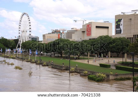 BRISBANE, QUEENSLAND/AUSTRALIA - JANUARY 13: Flooded street with Farris wheel on January 13, 2011 in South Bank, Brisbane, Queensland, Australia. - stock photo