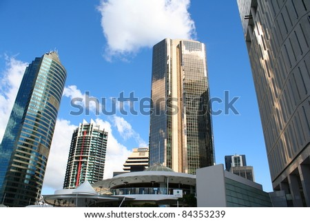 Brisbane's skyscrapers with sunny sky in the background - stock photo