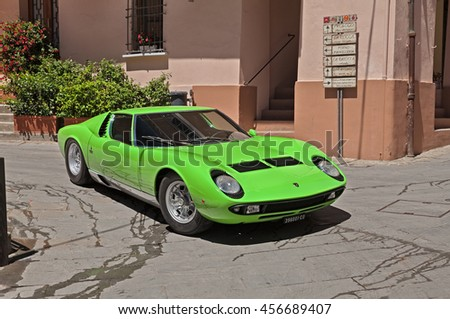 "BRISIGHELLA, RA, ITALY  - JULY 17: classic sports car Lamborghini Miura of the sixties in rally ""Trofeo Lorenzo Bandini"" dedicated to the 60s Formula One driver. July 17 2016 in Brisighella, RA, Italy"