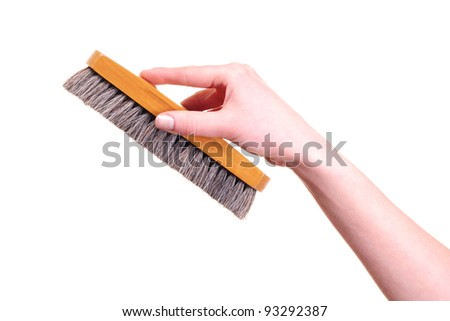 bristle brush in the hand isolated on white background