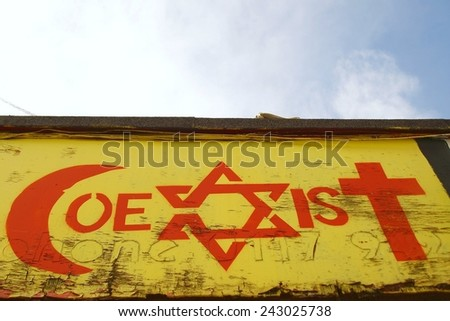 BRISTOL - AUG 31: View of a religious tolerance themed graffiti piece by an unidentified artist on a city centre building on Aug 31, 2009 in Bristol, UK. Bristol is known for its multiculturalism.  - stock photo