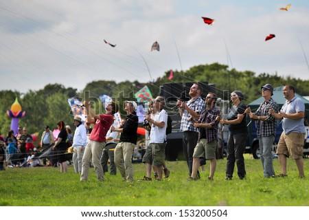 BRISTOL - AUGUST 31: The Decorators revolution kite team at the 2013 Bristol International Kite Festival, England, August 31, 2013  - stock photo