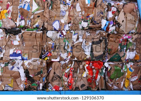 BRISTOL, ENGLAND - FEBRUARY 3: Cardboard stacked on a wagon prior to processing at a recycling plant in Bristol, England on February 3, 2013