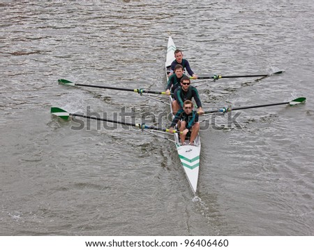 BRISTOL, ENGLAND - FEBRUARY 19: Four man crew from the City of Bristol rowing club racing in the annual Head of the River race in Bristol, England on February 19, 2012. One hundred teams entered